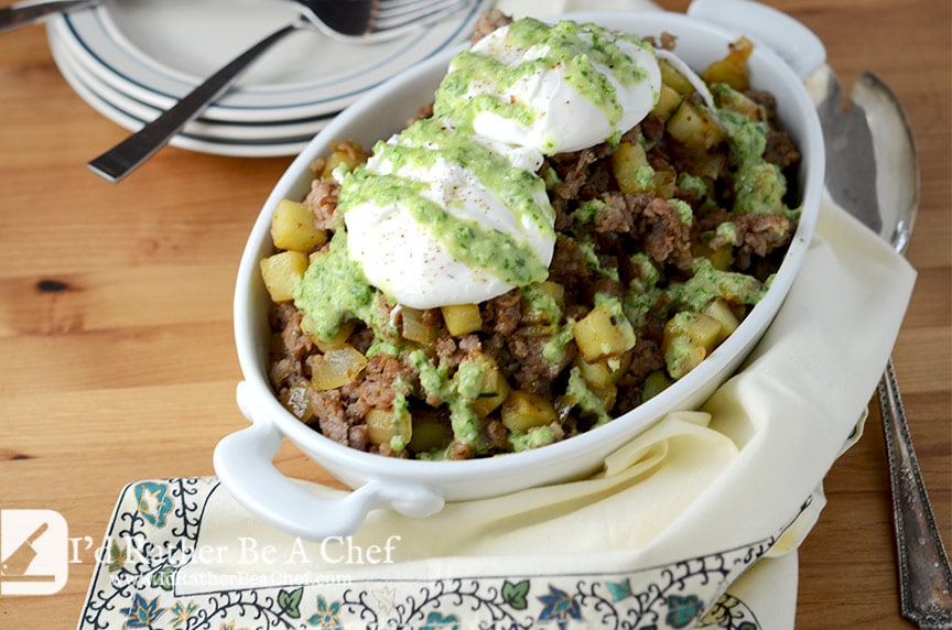 paleo sweet potato hash recipe with poached eggs and a fresh tomatillo, parsley & chive salsa!
